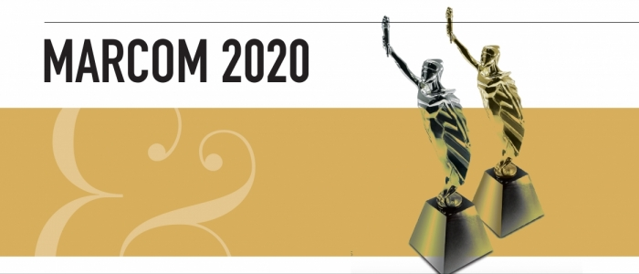 Text reads MarCom 2020. There is a white and gold rectangular background. Two award figures, one gold, one silver, are on the right hand side.